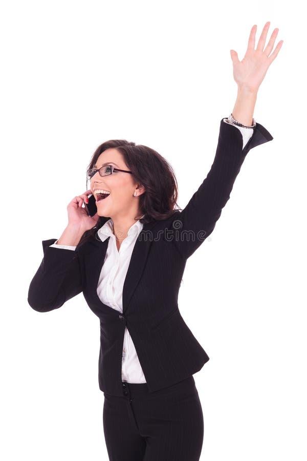 Mulher de negócio vitorioso no telefone imagens de stock