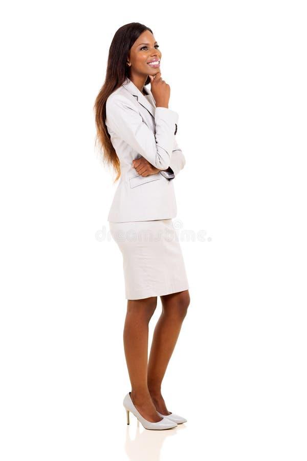 Mulher de negócios africana pensativa fotografia de stock