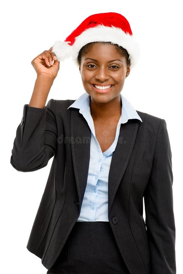 Mulher de negócios afro-americano que faz um chapéu vestindo do Natal do wsih foto de stock royalty free
