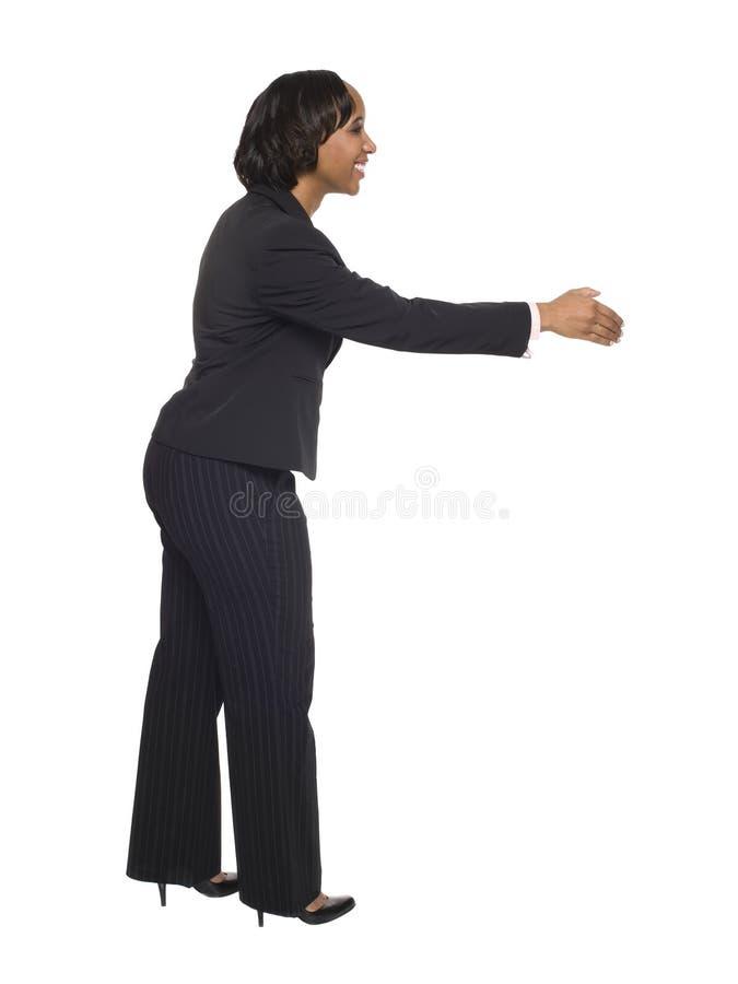 Mulher de negócios - aperto de mão imagem de stock royalty free