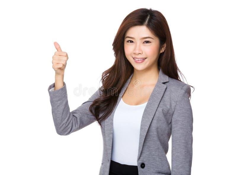 Mulher de negócios asiática com polegar acima foto de stock