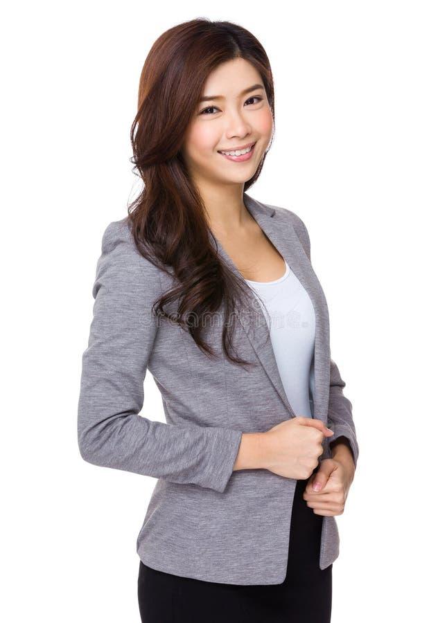 Mulher de negócios asiática nova no fundo branco fotografia de stock