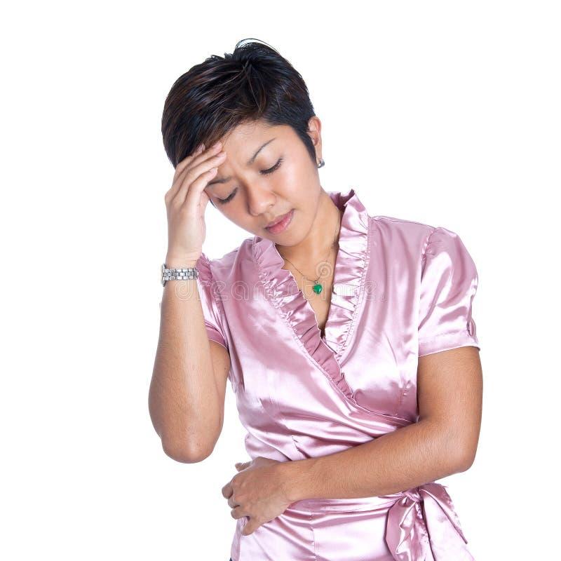 A mulher de negócios asiática sofre o esforço fotografia de stock
