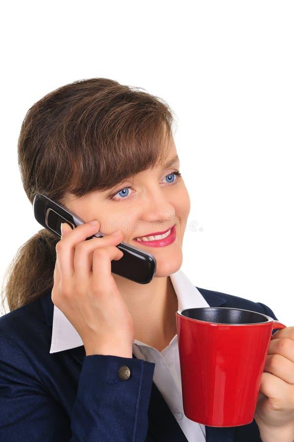 Mulher de negócios atrativa com uma chávena de café imagens de stock royalty free
