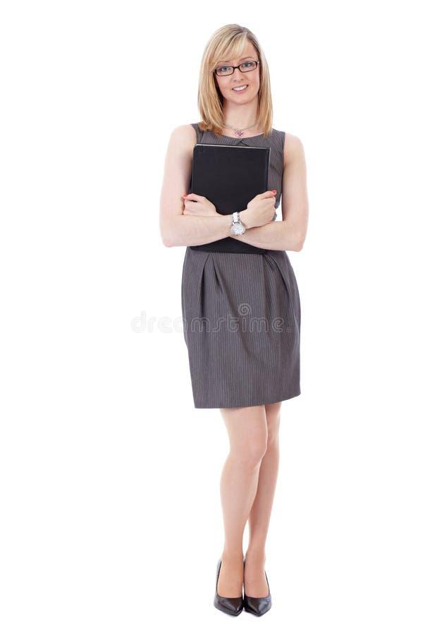 A mulher de negócios atrativa prende o diário de couro preto foto de stock