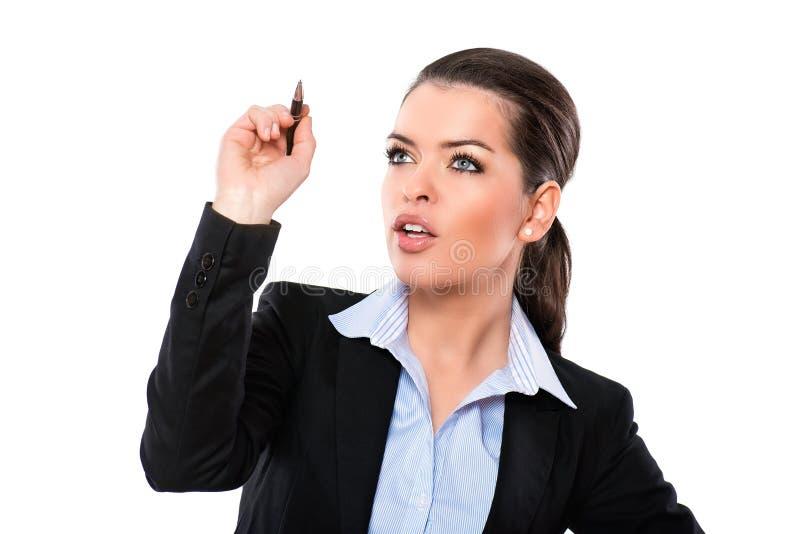 Mulher de negócios atrativa que escreve um plano foto de stock