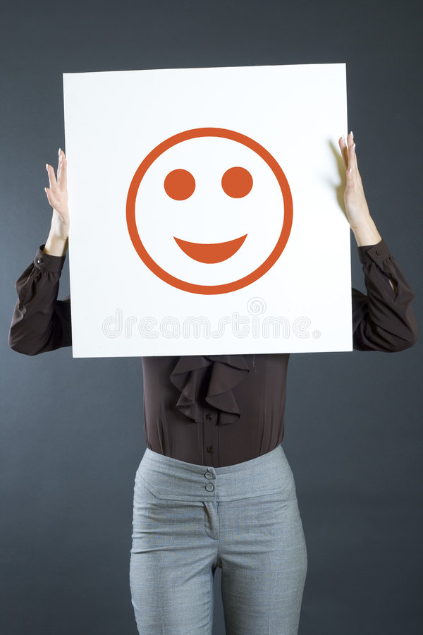 Mulher de negócios atrativa que prende uma placa fotos de stock