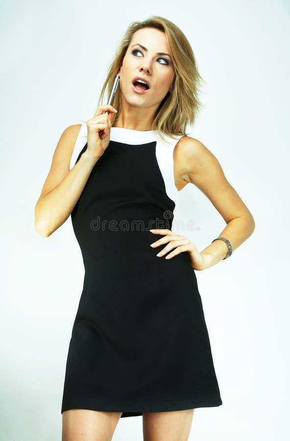Mulher de negócios bem sucedida feliz com pena fotos de stock royalty free