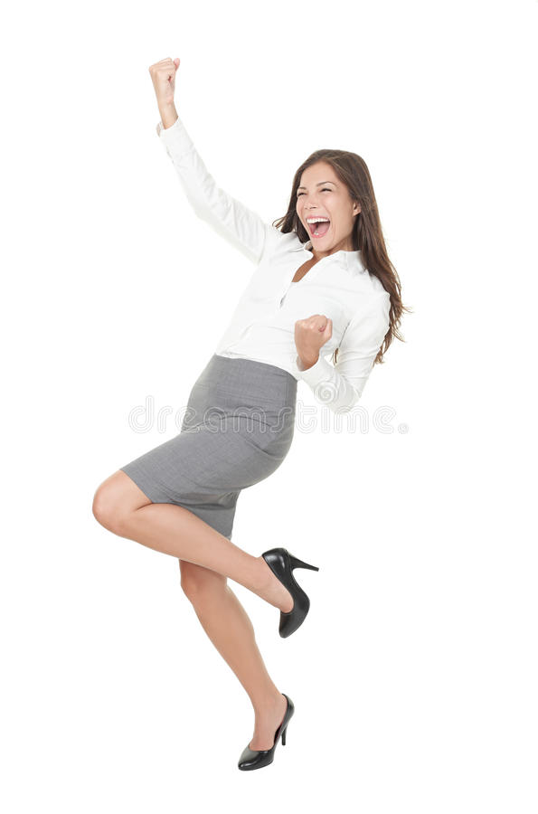 Mulher de negócios bem sucedida nova que comemora o sucesso imagem de stock