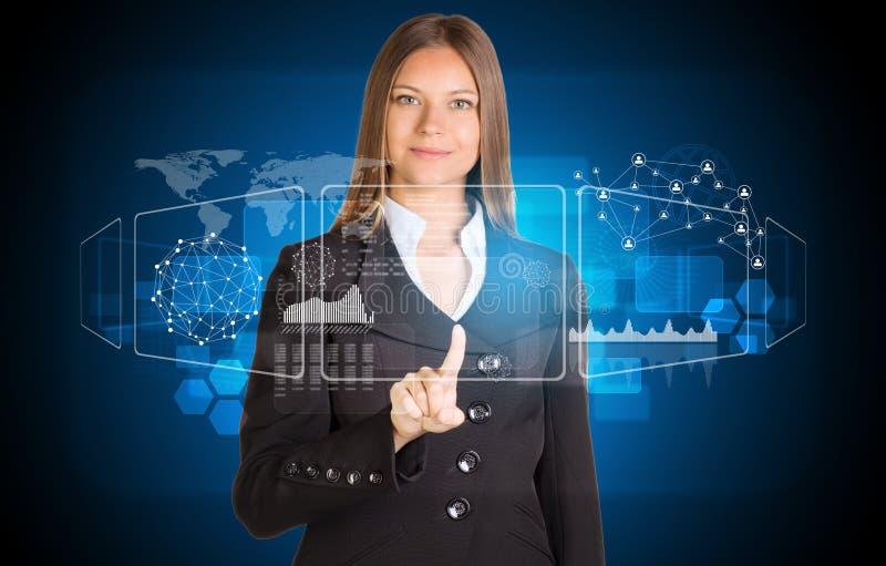 Mulher de negócios bonita no terno que aponta o dedo sobre imagens de stock royalty free