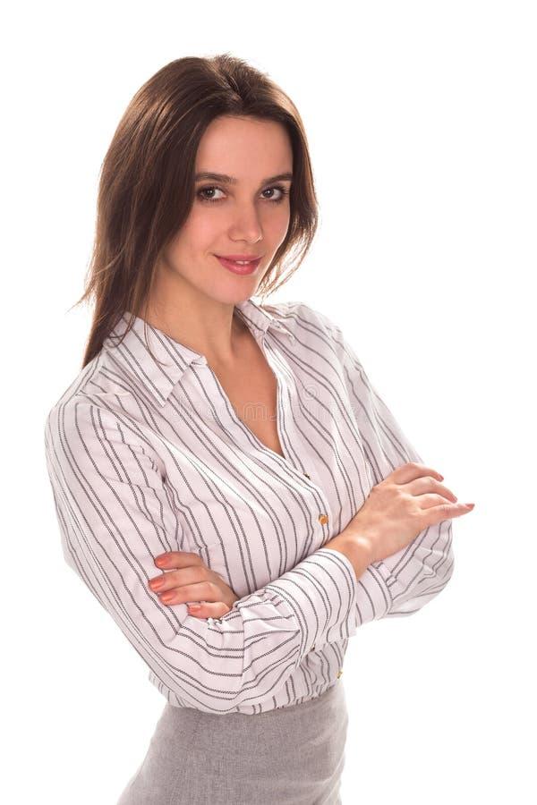 Mulher de negócios bonita nova com o braço dobrado Retrato completo da altura foto de stock royalty free