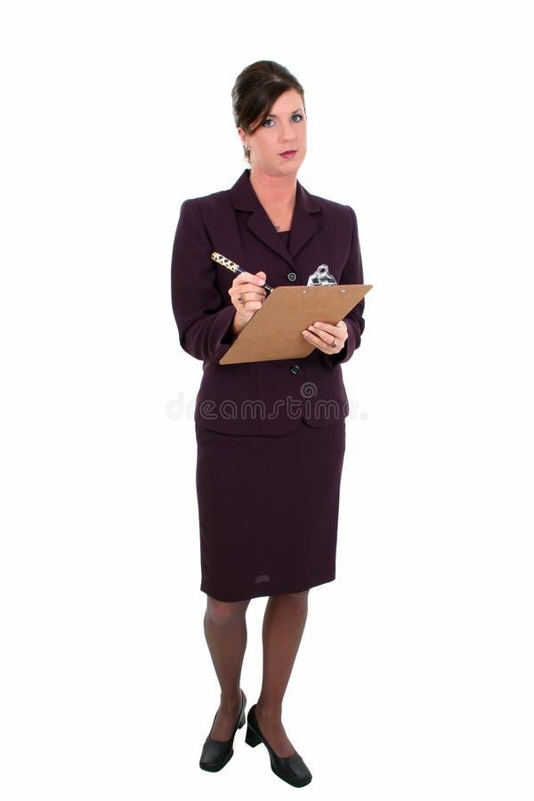 Mulher de negócios bonita que toma notas imagem de stock