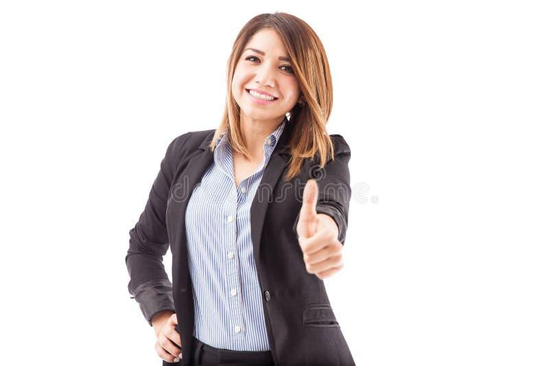 Mulher de negócios bonito com um polegar acima imagem de stock
