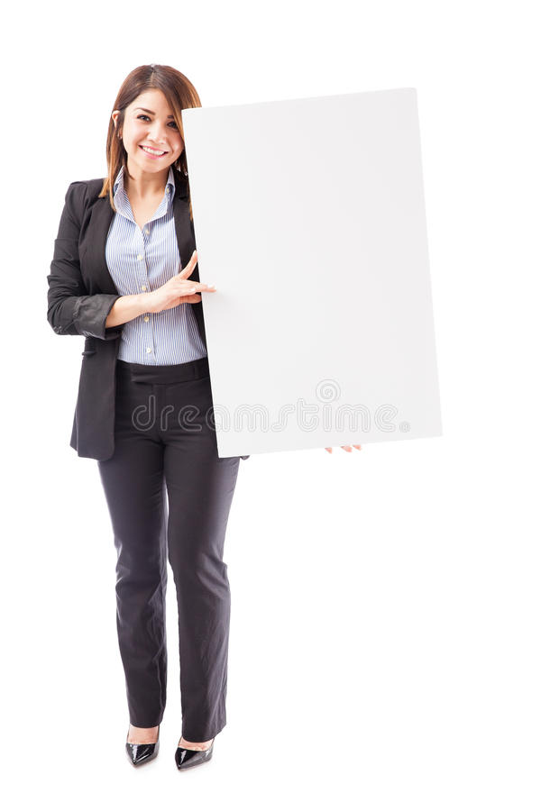 Mulher de negócios bonito com um sinal grande imagem de stock