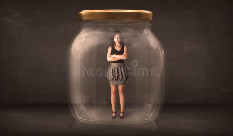 Mulher de negócios capturada em um conceito de vidro do frasco imagens de stock