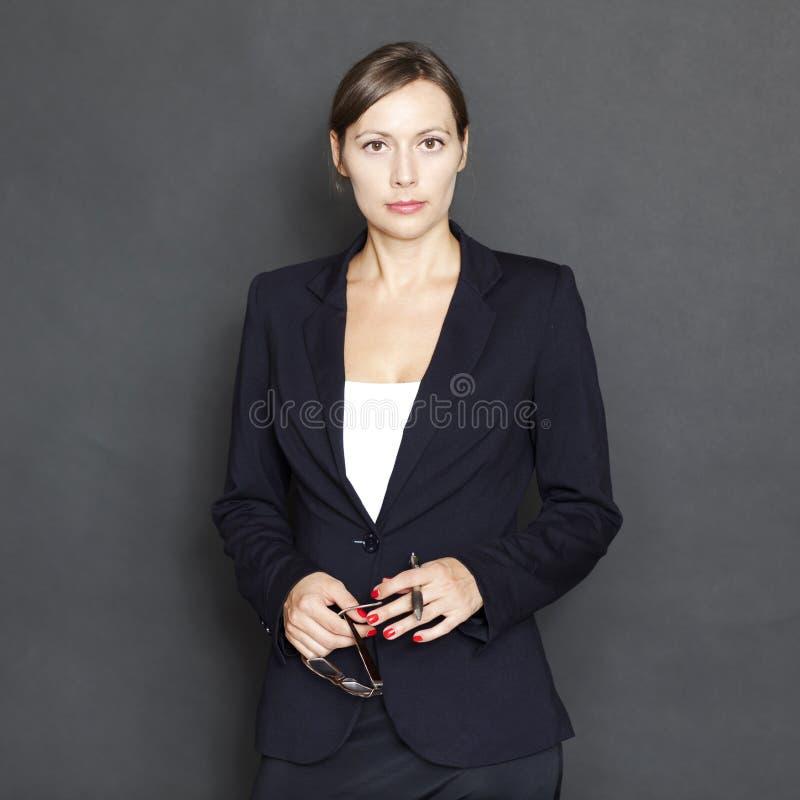 Mulher de negócios caucasiano com vidros fotografia de stock royalty free