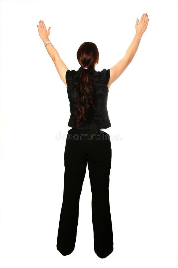 A mulher de negócios com ambos os braços levanta acima imagens de stock