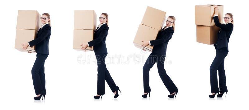 A mulher de negócios com as caixas isoladas no branco imagem de stock