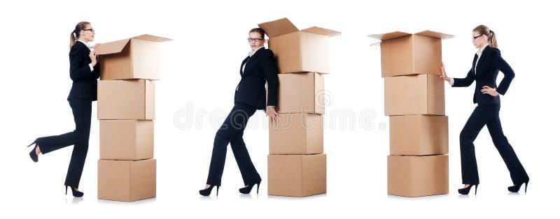 A mulher de negócios com as caixas no branco imagem de stock