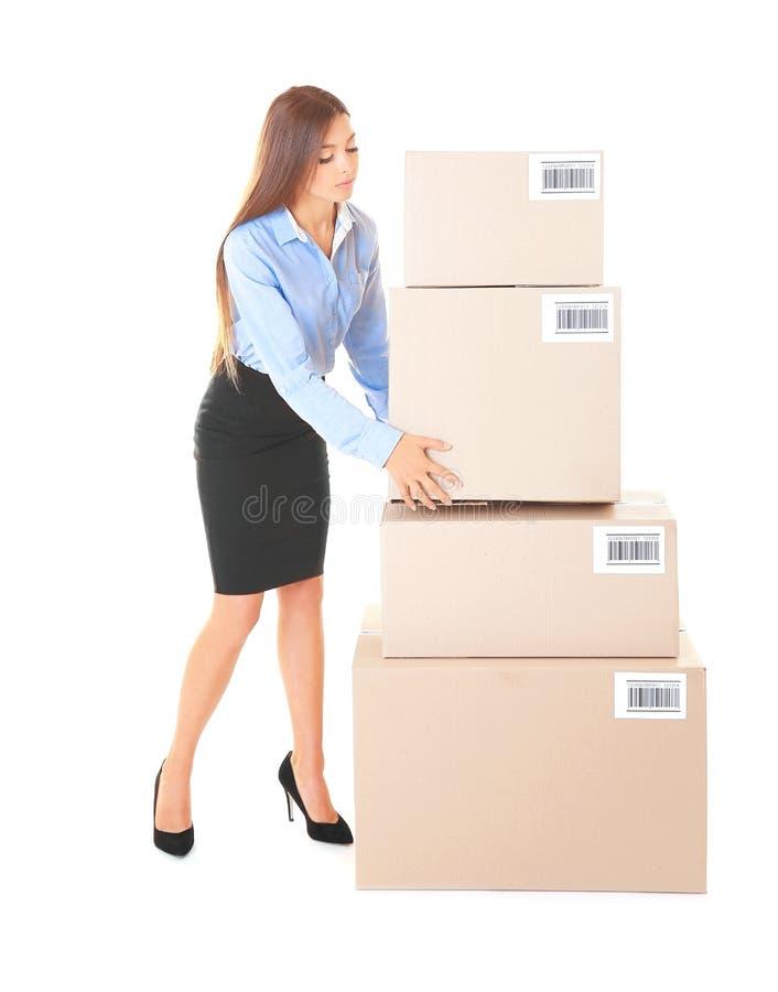 Mulher de negócios com as caixas no fundo branco fotografia de stock