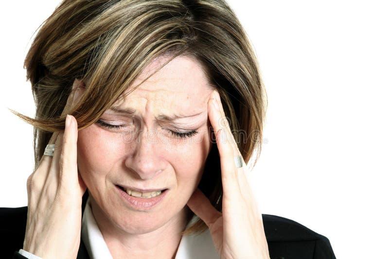 Mulher de negócios com dor de cabeça foto de stock royalty free