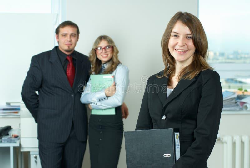 Mulher de negócios com equipe foto de stock