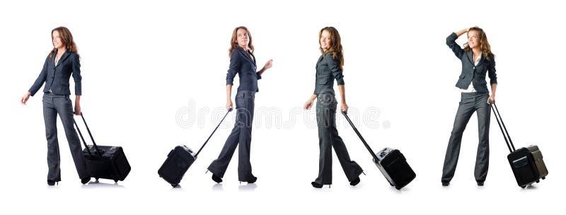 A mulher de negócios com a mala de viagem no branco ilustração stock