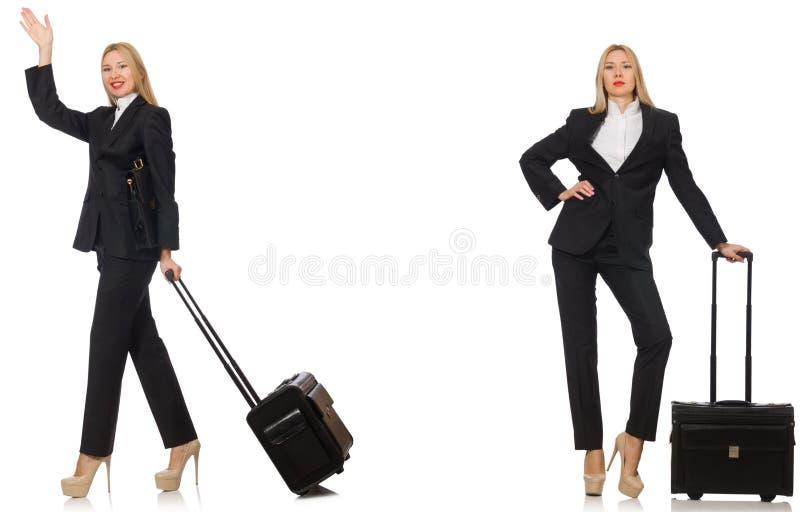 A mulher de negócios com a mala de viagem isolada no branco fotos de stock