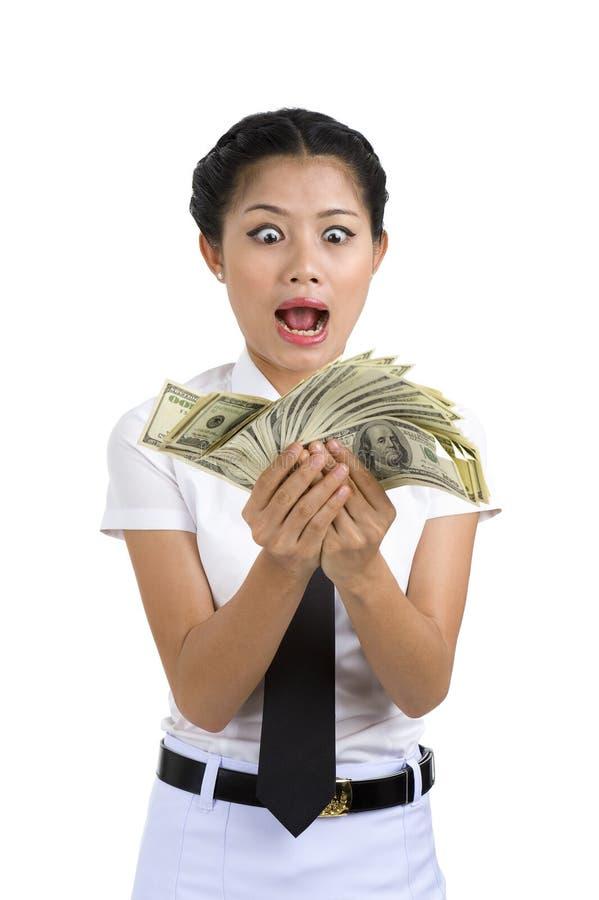 Mulher de negócios com muito dinheiro fotografia de stock
