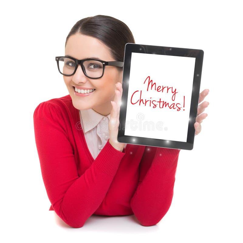 Mulher de negócios com o tablet pc que deseja o Feliz Natal fotografia de stock