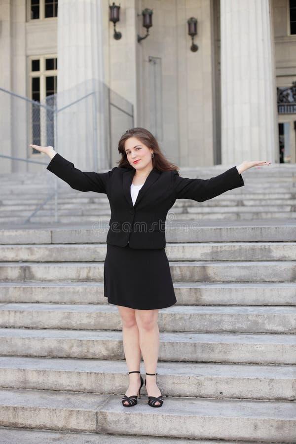 Mulher de negócios com os braços outstretched fotos de stock