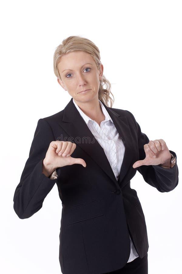Mulher de negócios com polegares para baixo fotografia de stock