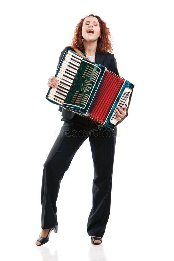 Mulher de negócios com um acordeão imagem de stock royalty free