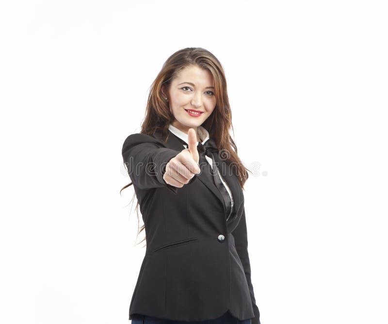 A mulher de negócios dá os polegares acima do sinal imagens de stock royalty free