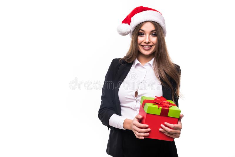 Mulher de negócios da beleza que aceita um presente do Natal isolado no fundo branco imagem de stock