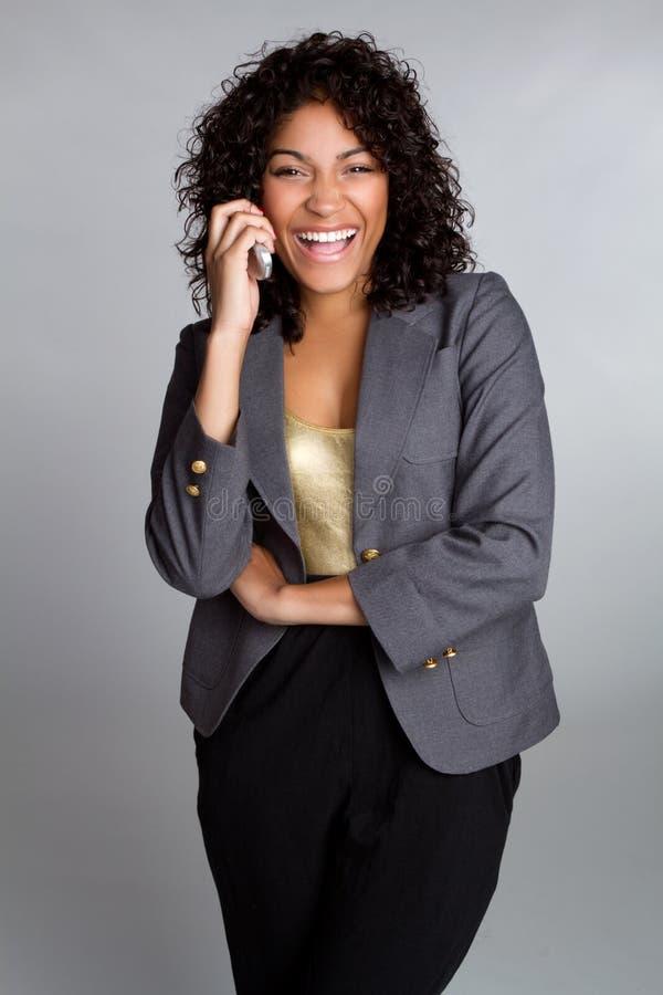 Mulher de negócios de riso do telefone foto de stock