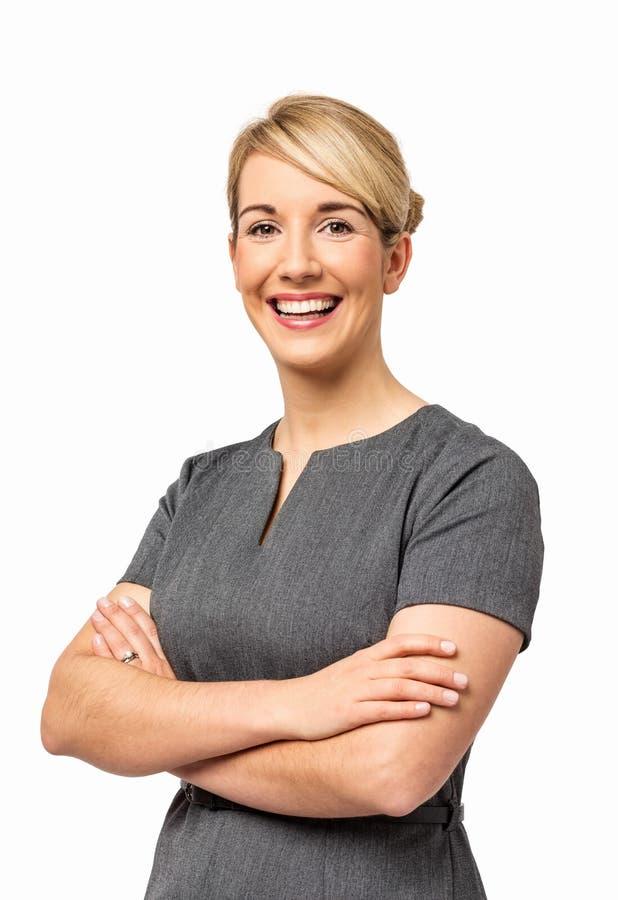 Mulher de negócios de sorriso With Arms Crossed foto de stock royalty free