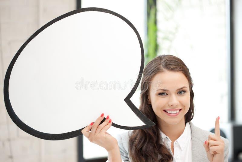 Mulher de negócios de sorriso com bolha em branco do texto foto de stock