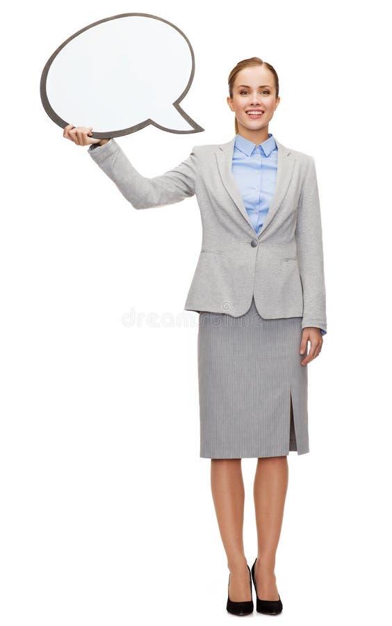 Mulher de negócios de sorriso com bolha vazia do texto fotos de stock