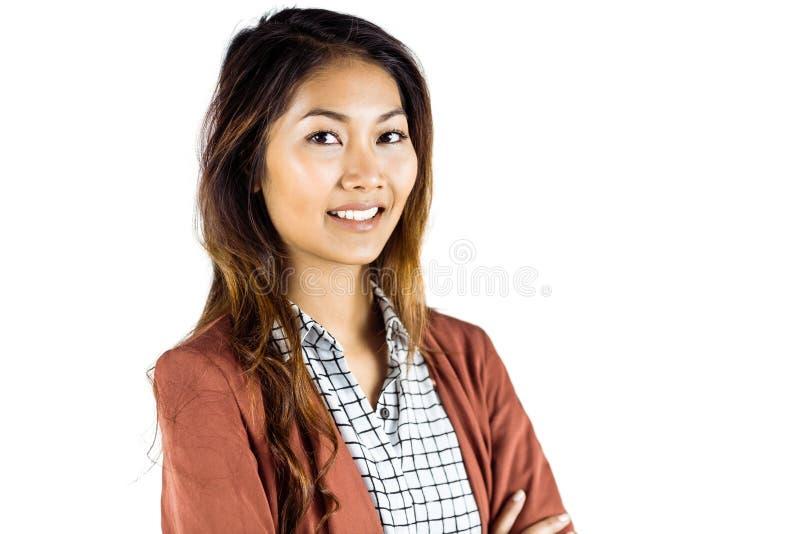 Mulher de negócios de sorriso com braços cruzados fotos de stock royalty free