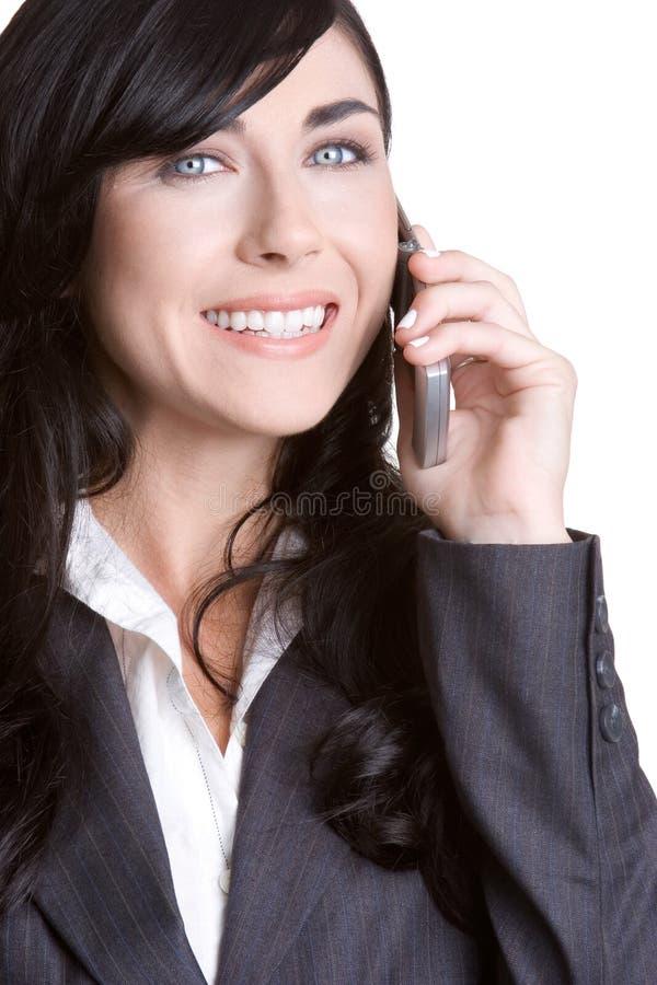 Mulher de negócios de sorriso do telefone imagens de stock royalty free