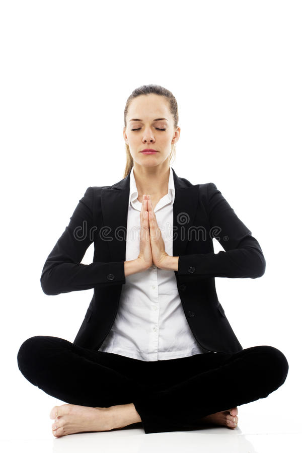 Mulher de negócios de Yyoung que faz a ioga imagem de stock royalty free