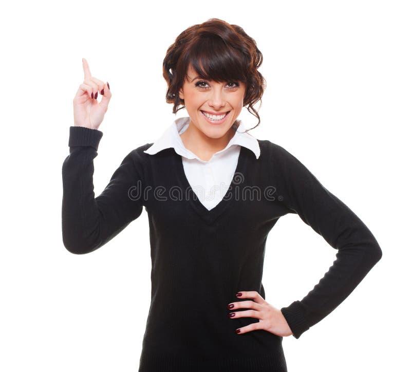 Mulher de negócios do smiley que aponta acima fotografia de stock royalty free