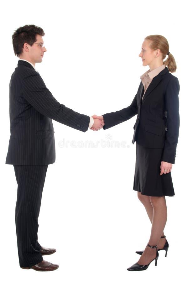 Mulher de negócios e homem de negócios que agitam as mãos foto de stock royalty free