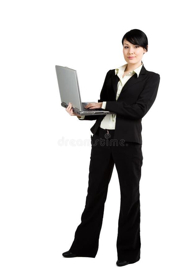 Mulher de negócios e portátil imagens de stock