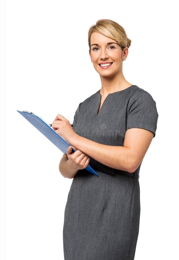 Mulher de negócios feliz With Clipboard imagens de stock