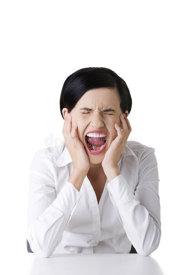 Mulher de negócios forçada ou irritada que grita imagem de stock royalty free