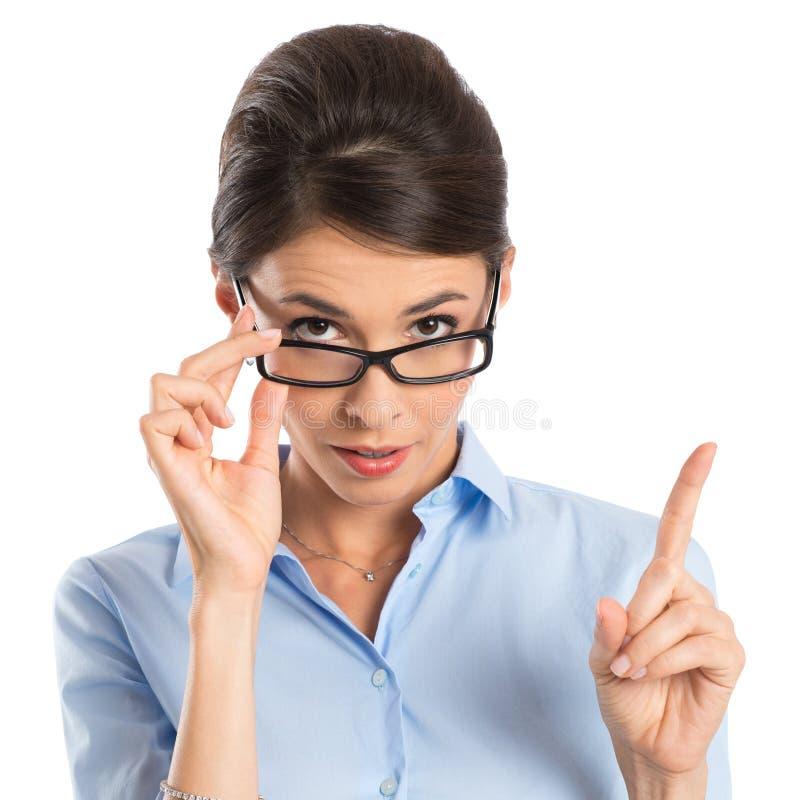 Mulher de negócios Holding Eyeglasses fotografia de stock royalty free