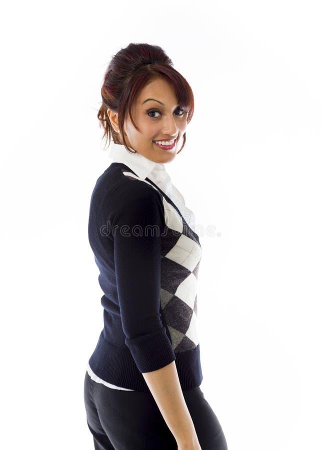 Mulher de negócios indiana que gira isolado para trás no fundo branco imagem de stock