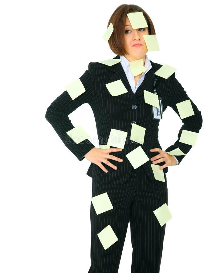 Mulher de negócios insolúvel completamente do post-it vazio imagem de stock royalty free